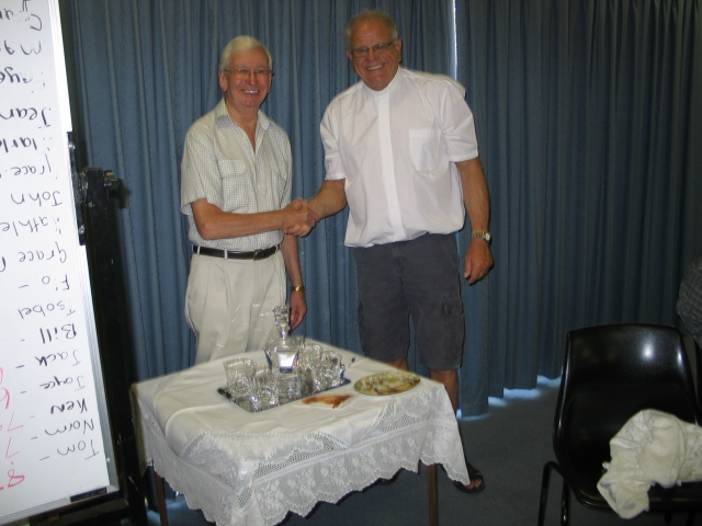 Presentation to Fr Kim by Parish Secretary Lou Hamon